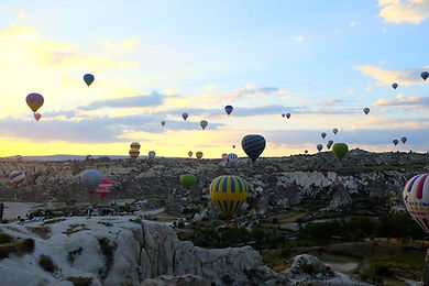 Typical hot air balloons at sunrise