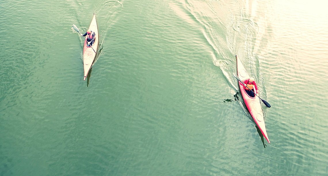 High Angle View Of People Kayaking In Lake