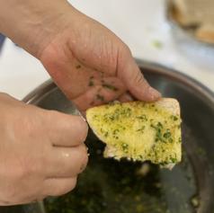 Prepping garlic bread
