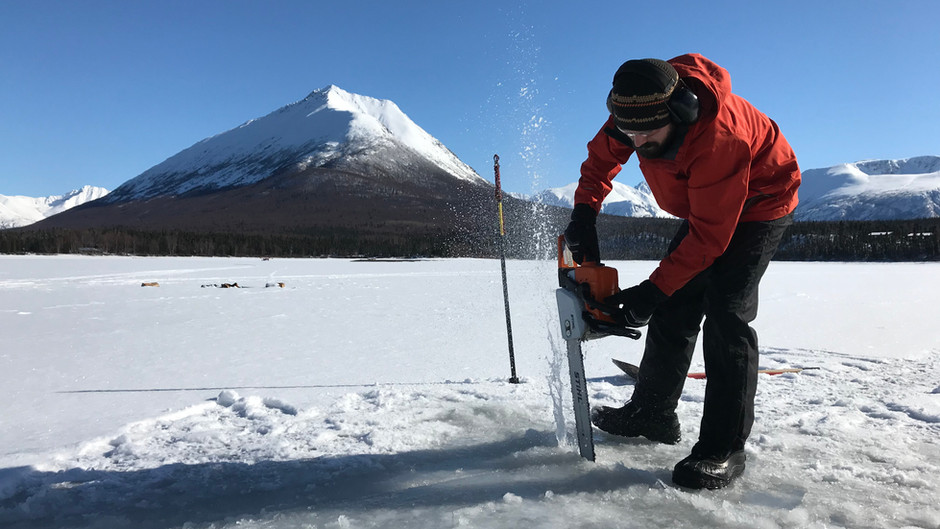 When the lake is frozen, how do you baptize someone?