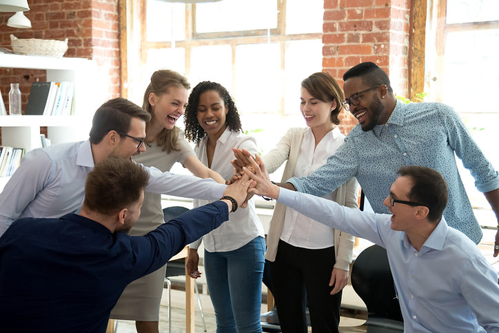 Photo of a group of diverse adults putting their hands in the circle representing a happy team of therapists. Learn about starting a private practice in Florida, New York, Colorado, Texas, Calfornia, or anywhere from therapist consultants at Private Practice Startup