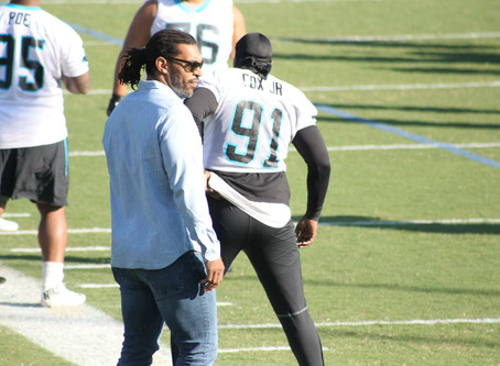 Julius Peppers looks on as Gerald McCoy prepares to take center stage.