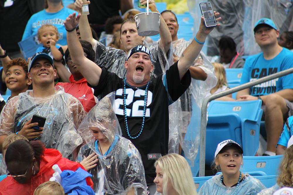 Fan wearing Christian McCaffrey jersey during Fan Fest
