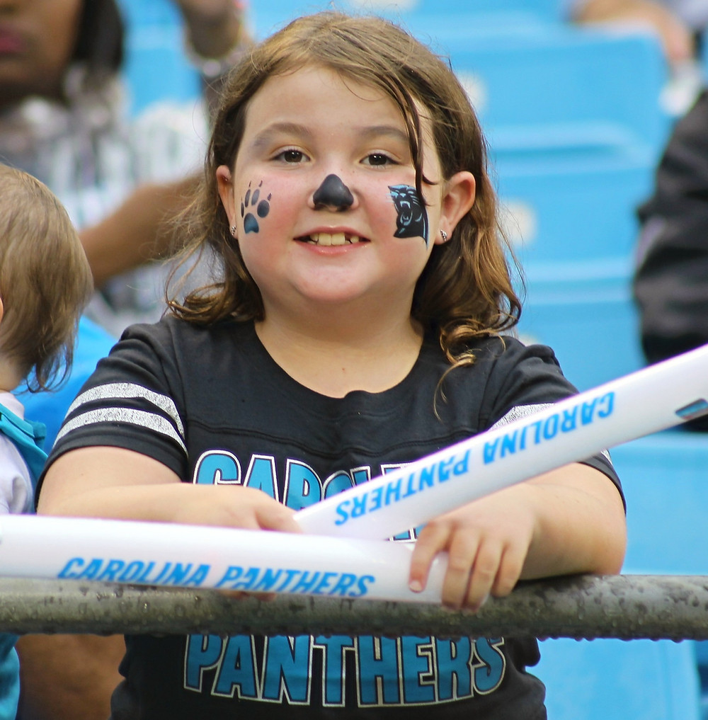 Young Carolina Panthers fan celebrates at 2019 Fan Fest