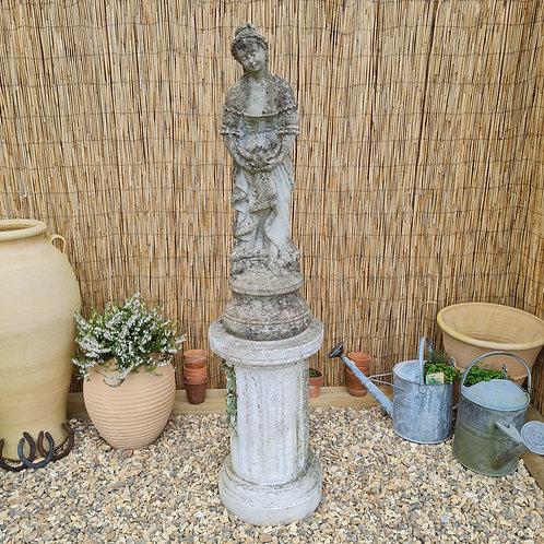 Weathered Statue on Plinth