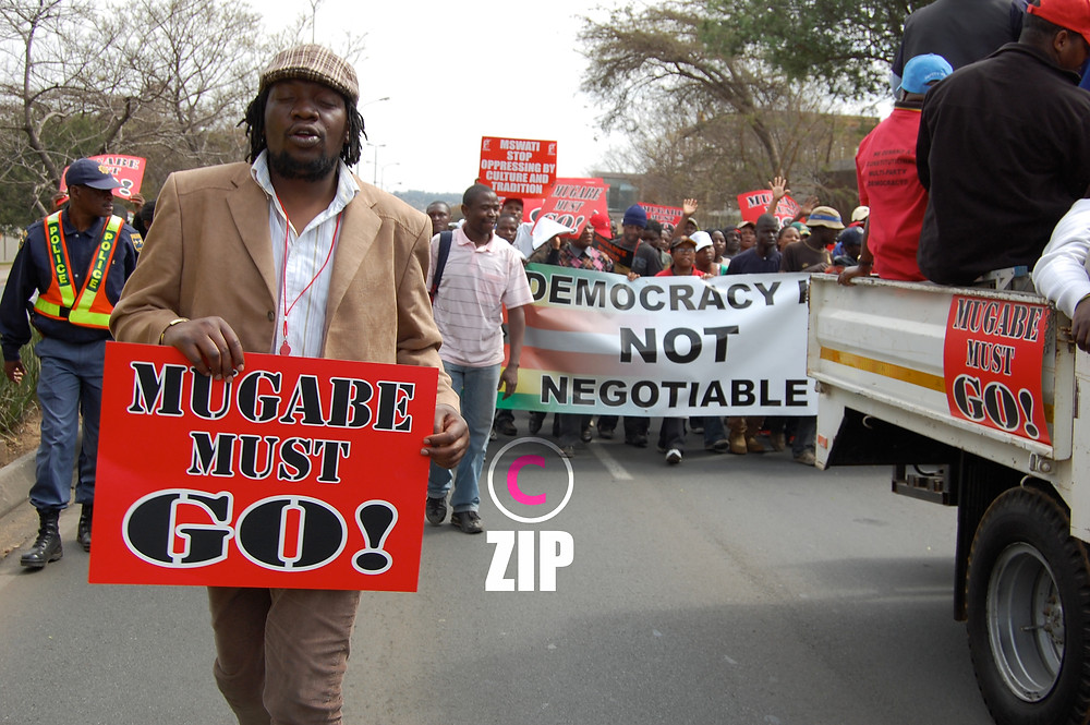 3.Activist Nixon 'Cde Mao' Nyikadzano joins a protest march to the Sandton Convention Centre were SADC Heads of State were meeting to discuss the Zimbabwe political crisis in August 2008.jpg