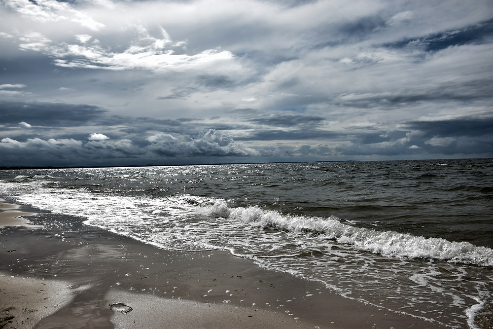 storm clouds out at sea from a beach