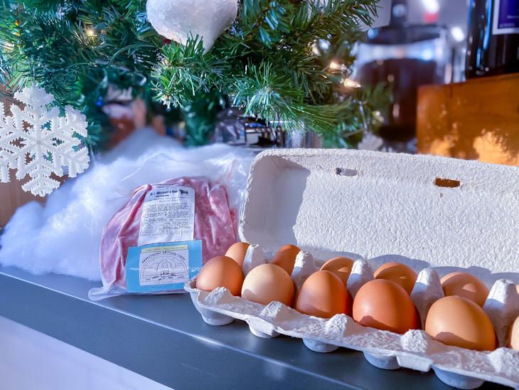 Armstrong artisan farms winston salem north carolina, eggs and ground sausage under Christmas tree.