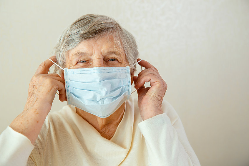 elderly-woman-puts-medical-mask-her-face