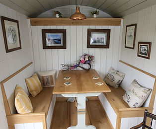 Eating in the shepherd hut.JPG