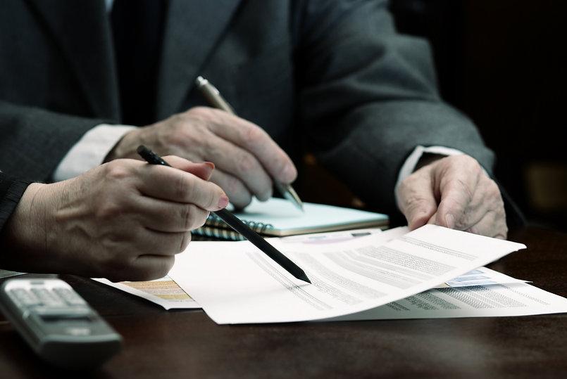 male hands going over paperwork.jpg