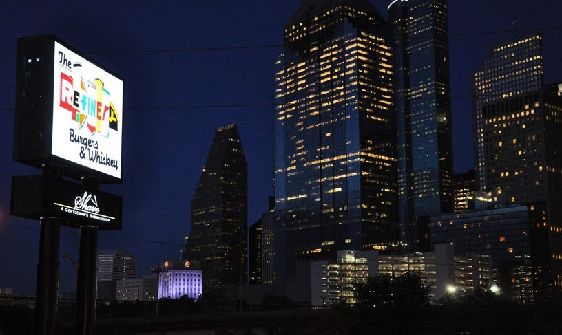 The Refinery and Shave in Downtown Houston: pylon sign.