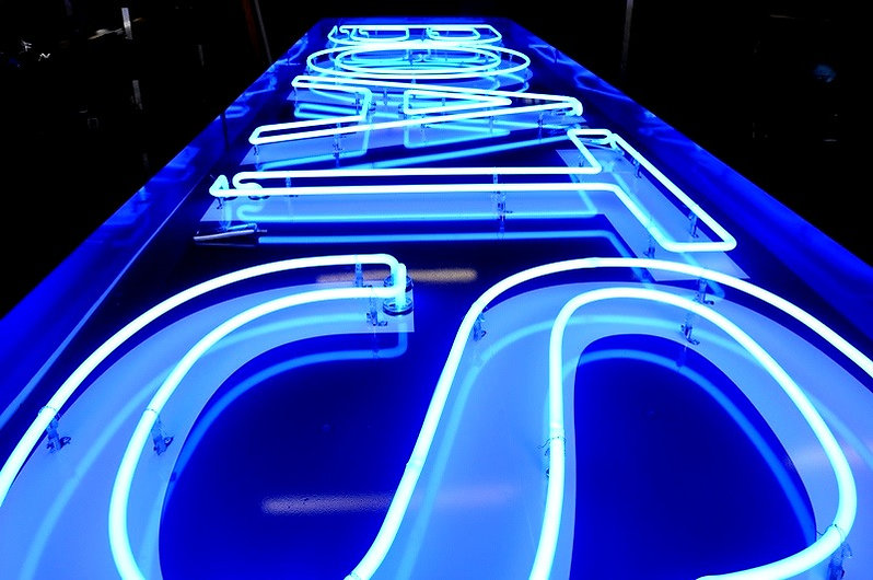 Boats neon sign in the color blue.