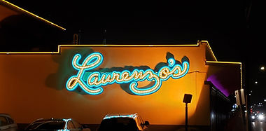 Laurenzo's Restaurant light up cursive channel letter wall sign with vintage LED light bulbs and outlined in turquoise neon.