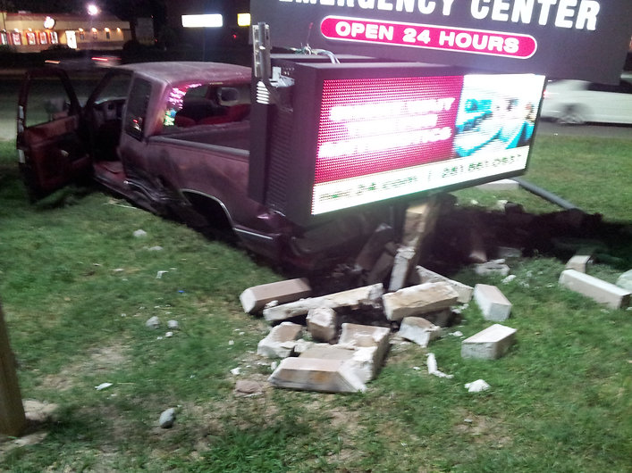 Neighbors Emergency Center in Pasadena, TX: truck wrecked into LED monument sign.