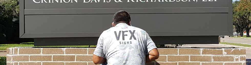 Visual FX Signs workman installing a monument sign for Wilfried Schmitz Attorney at Law.