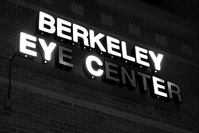 Berkeley Eye Center wall sign with several lights not working.