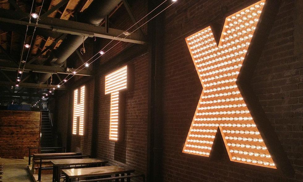 Bovine & Barley bulb-lit interior HTX channel letter sign.