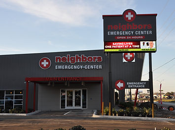 Neighbors Emergency Center light up wall sign and LED display pylon sign.