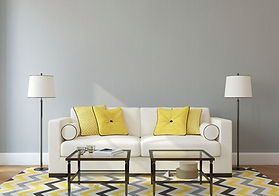 living room with couch, throw pillows, lamps and coffee tables