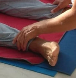 hand touch foot yoga.jpg