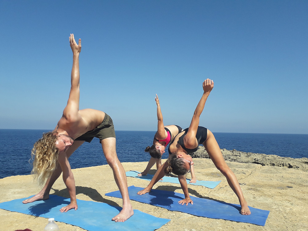 Outdoor yoga in Gozo as preparation for a Freediving Session
