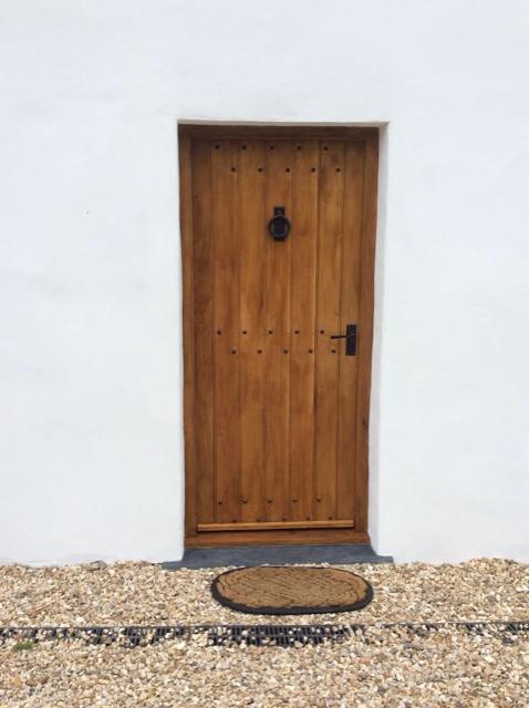 Oak frind door with black studs