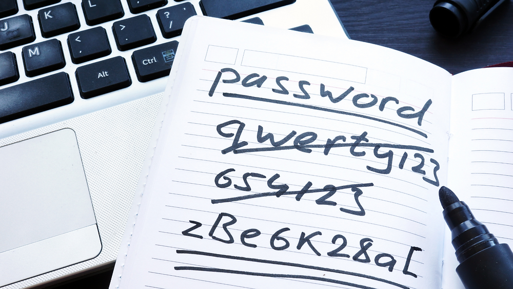 Strong and weak easy Password. Note pad and laptop