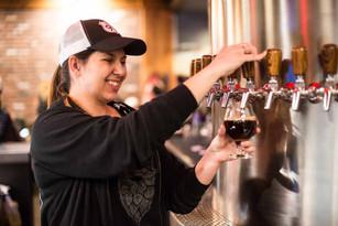 Bartender Serving Beer At Silver Moon Br
