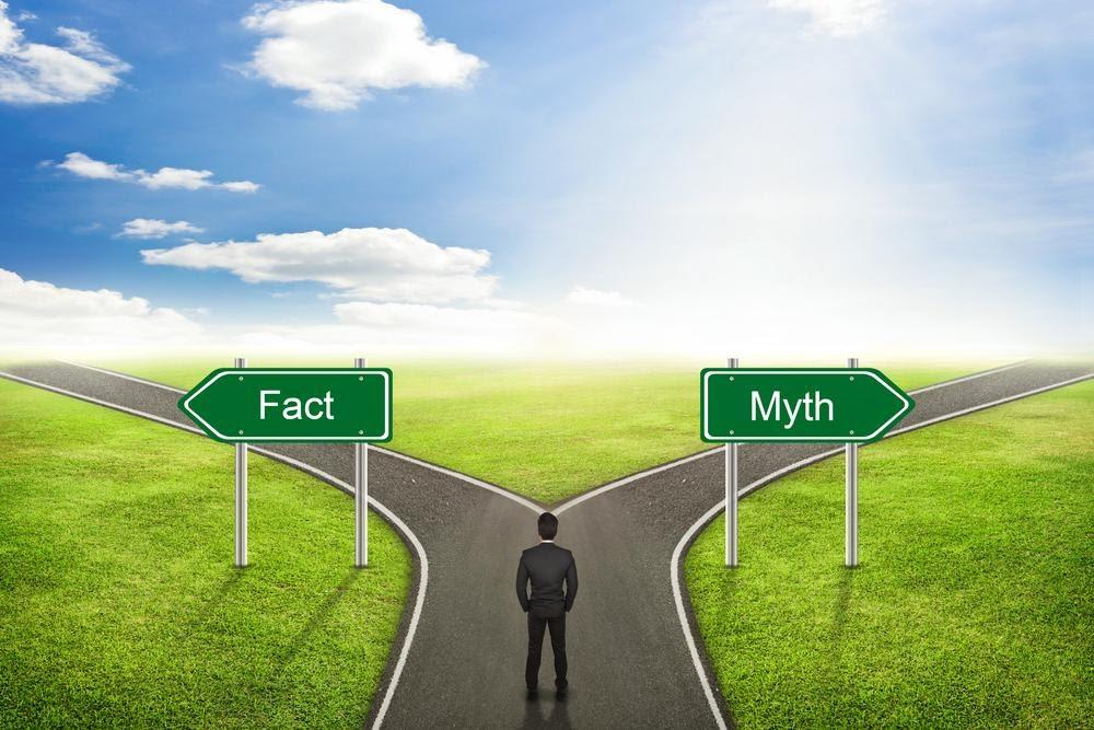 man standing at crossroads fact vs. myth