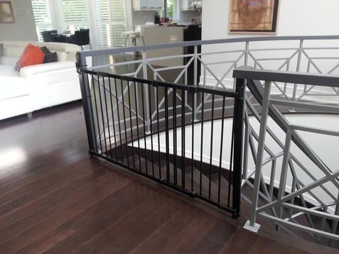 Gate on metal railings