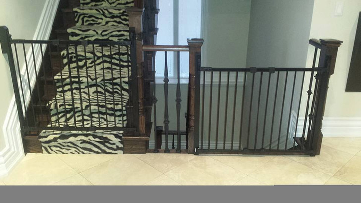 Side by side stairs with black angle mount gates