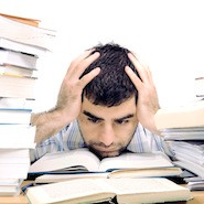 Male student with his head in the books