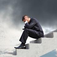 Man upset sitting on stairs