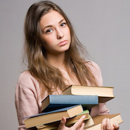 Unimpressed student carrying books