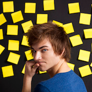 Male student standing infront of sticky notes