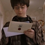 Harry Potter reading a letter