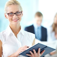 Female employee smiling with open book