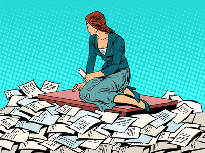 Woman sitting on desk surrounded by papers