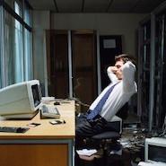 Man sitting at messy desk