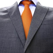 Grey suit and orange tie