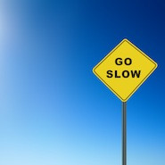 Go Slow road sign