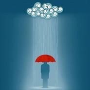 Man standing under a rain cloud
