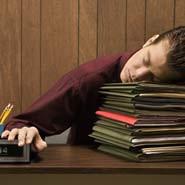 Boy sleeping on files