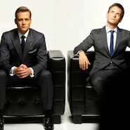 Suits TV show characters sitting in chairs