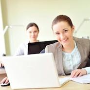 Smiling employee at laptop