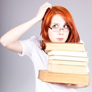 Confused student holding books