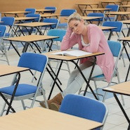 Disapointed student in empty exam hall