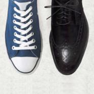 sneaker next to a black dress shoe