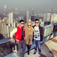 Three friends posing in Hong Kong